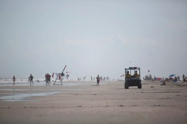 North Wildwood Police officers patrol the beach in 2017. On Tuesday, a woman died after attempting to rescue her children from rough waters.
