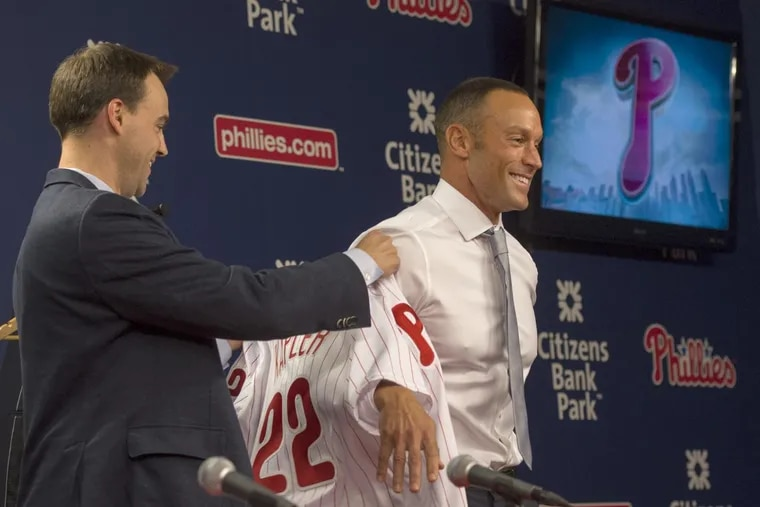 Philadelphia Phillies general manager Matthew Klentak (left) presents a jersey to Gabe Kapler as he is introduced as the 54th manager in team history.