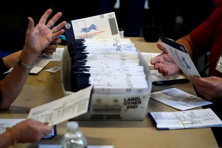 Chester County election workers process mail-in and absentee ballots for the 2020 general election in the United States at West Chester University in West Chester, Pa.