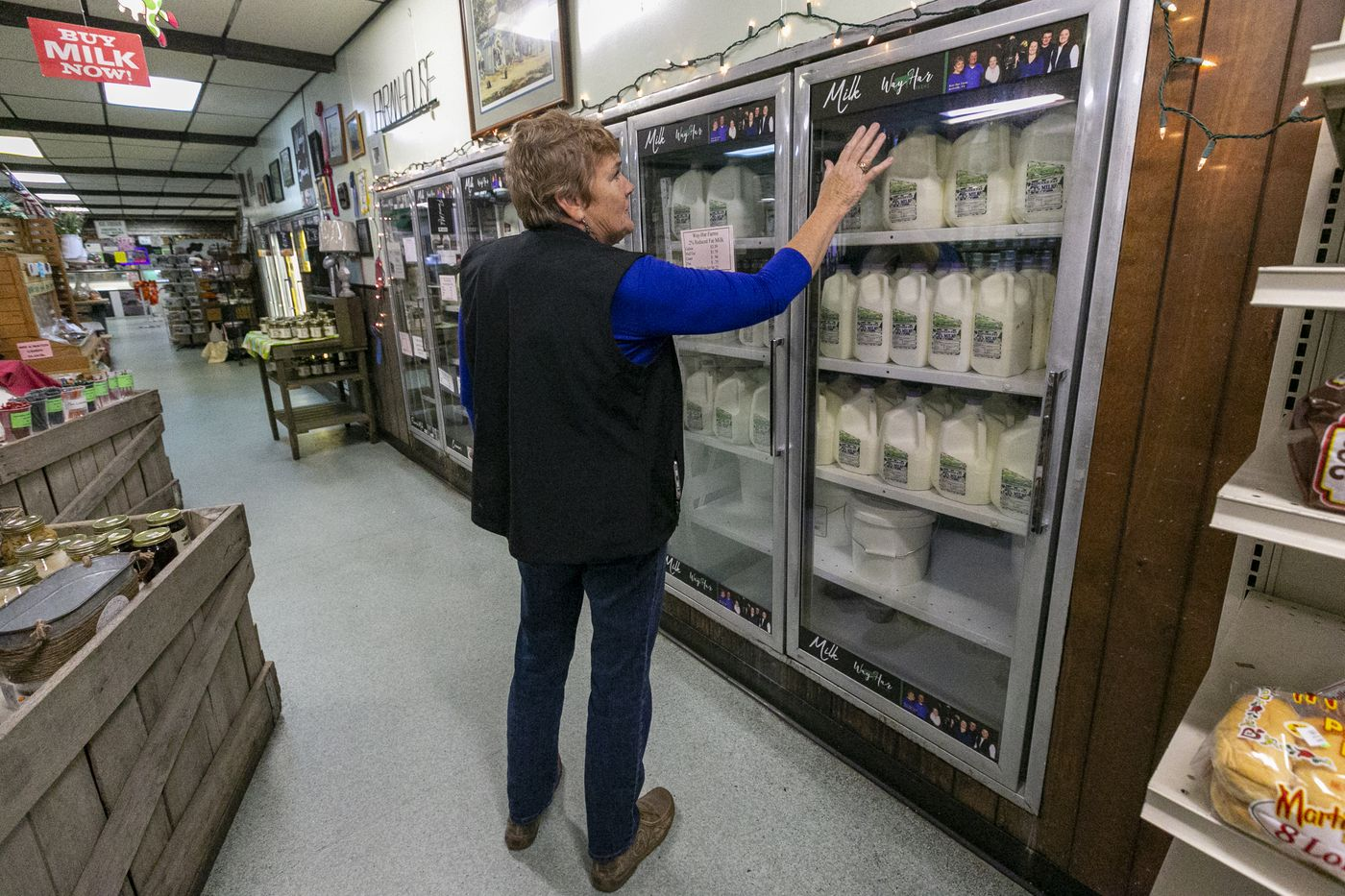 Dairy farmer Lolly Lesher in the dairy section at her Way-Har Farm Market in Bernville, Berks County. She doesn't sell plant-based alternatives such as almond and oat milk, and believes they don't belong on the same shelves as dairy products.