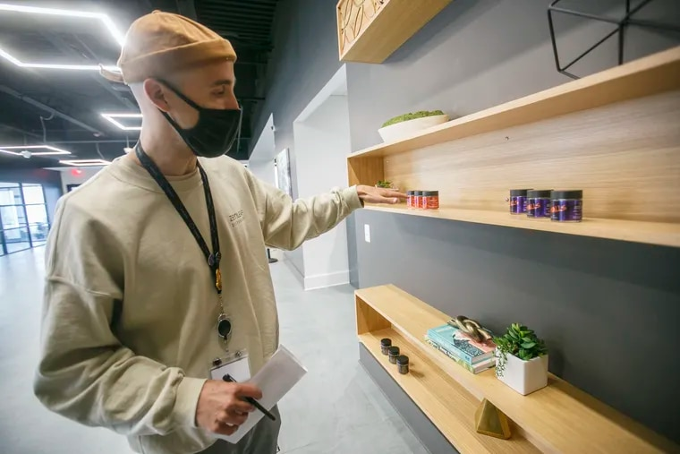 Jesse Pettyjohn, an employee of Zen Leaf, shows the cannabis products at the new dispensary in Neptune Township, N.J.