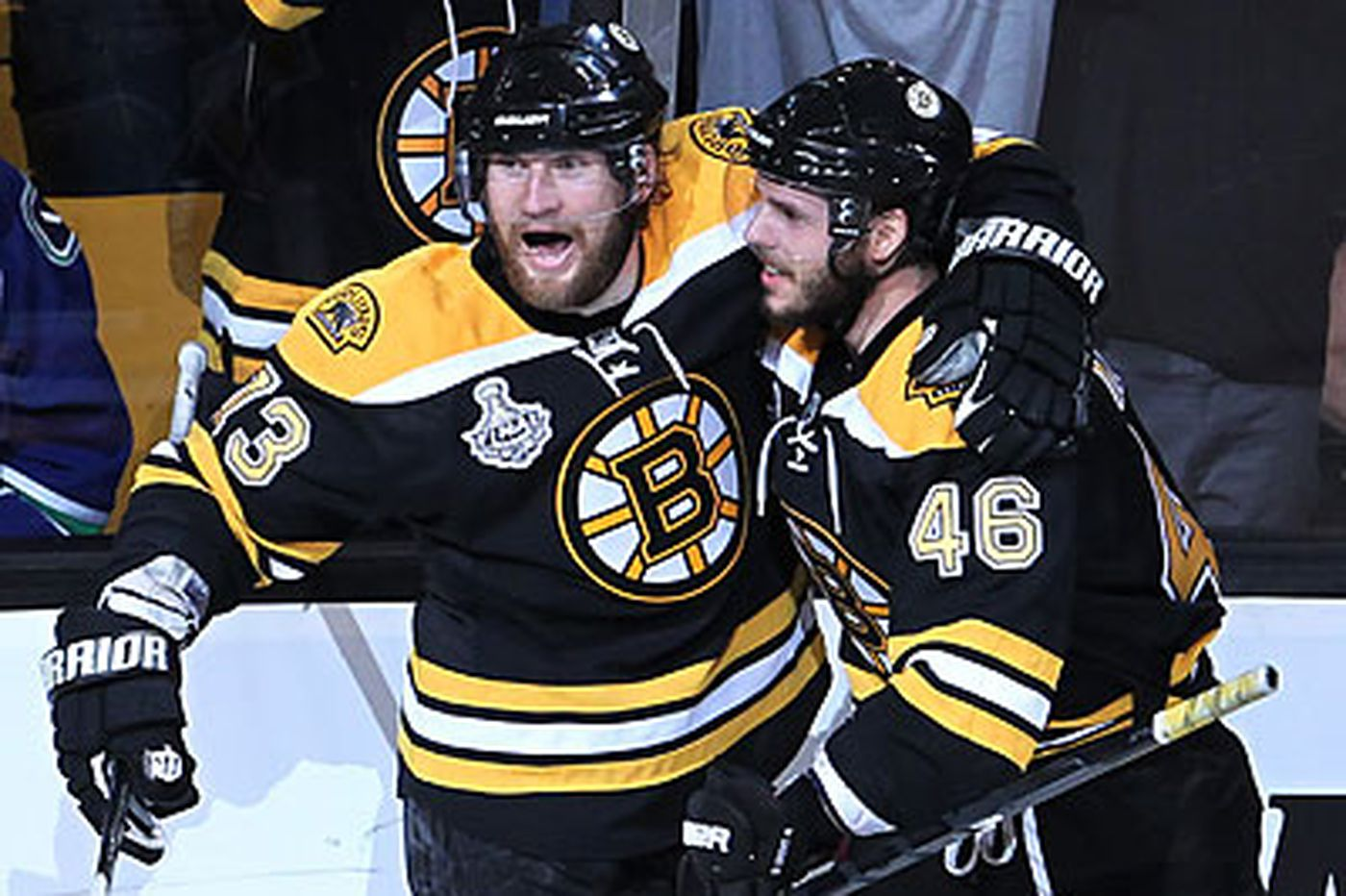 Bruins bite back, rout the Canucks