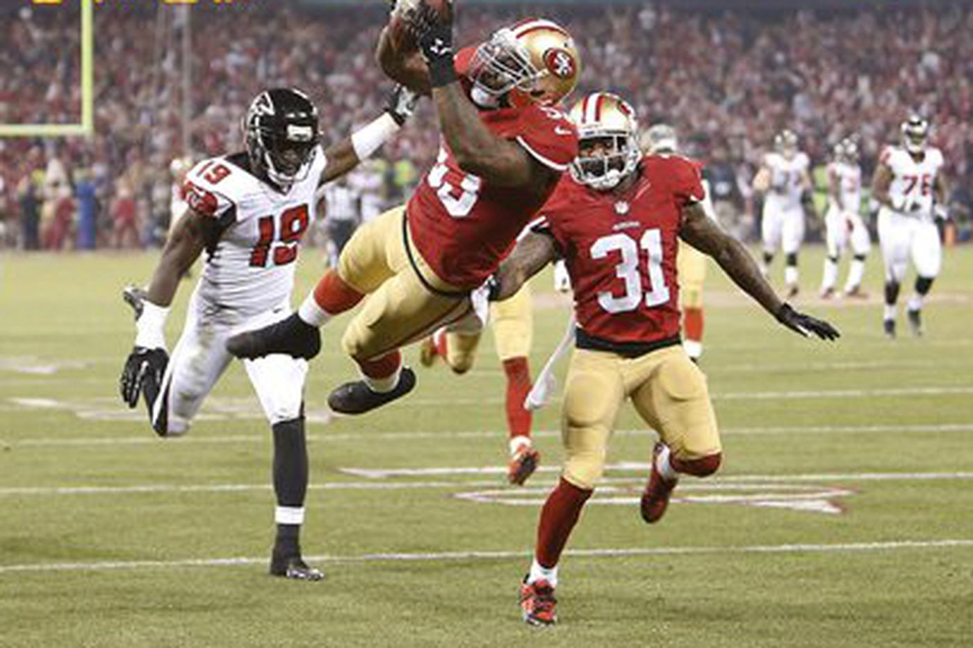 Niners hold off Falcons, earn playoff berth