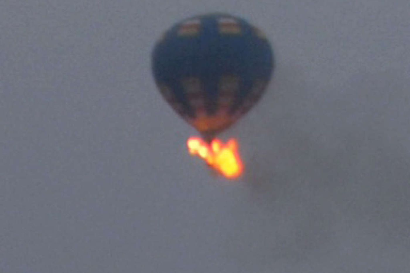 Balloon carrying three goes down in flames