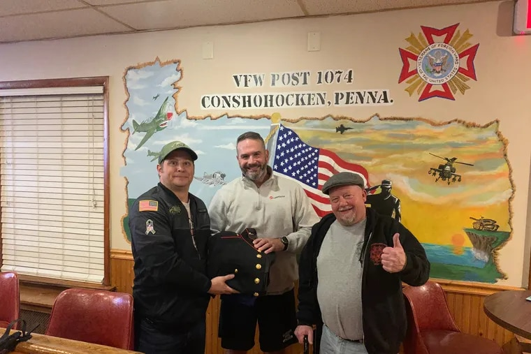 Richard Dunn (center) donated his Marine Corps uniform to Walt Hartnett (left) commander of Conshohocken VFW Post 1074, and Tom Smith (right), post quartermaster, to be used for Marine Corps veteran Samuel Jackson, who was killed in a hit-and-run crash Sunday in Norristown.
