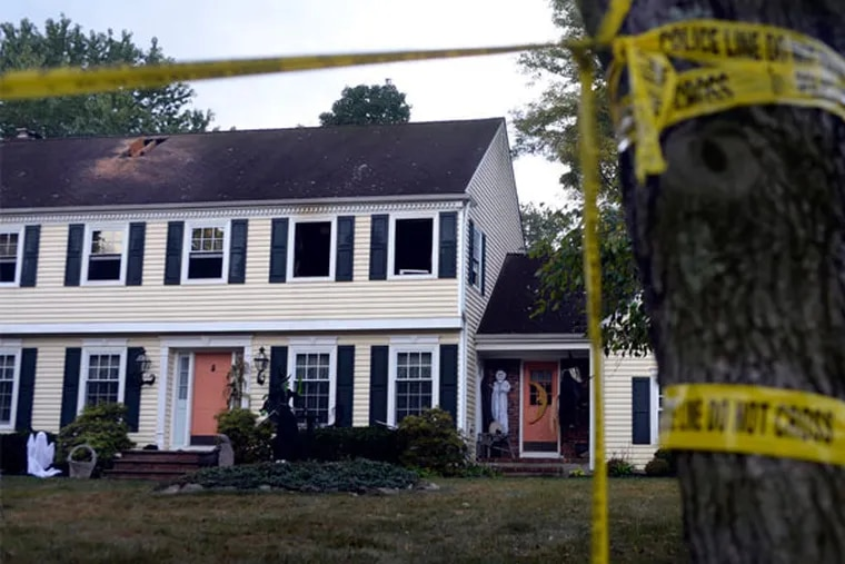 Crime scene tape cordons the house where John P. Sheridan Jr., president and CEO of the Cooper University Health System, and his wife wife, Joyce, were found dead after a fire Sunday. (Tom Gralish / Staff Photographer)