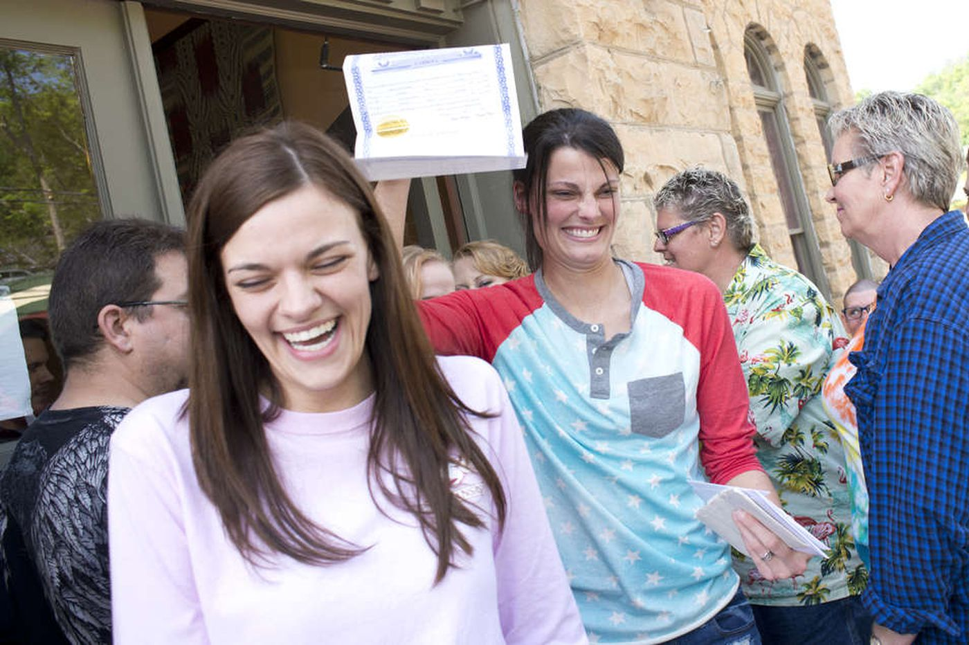 Same-sex marriages get rolling in Arkansas