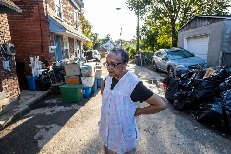 Irene Reese, 81, has spent all of her life except for six months living in homes on Cox Alley in Downingtown. She had to be rescued by a fire department boat when Ida hit.  On Saturday, she along with so many across the region continued cleaning up from the storm's ravages.