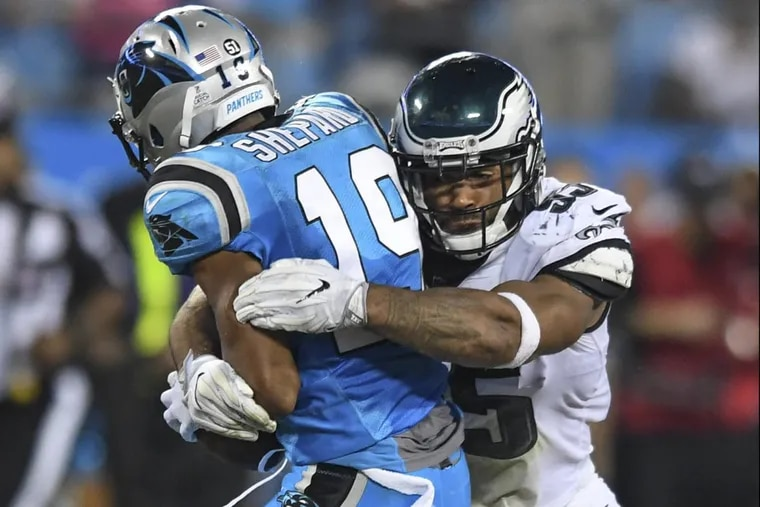 Eagles linebacker Mychal Kendricks stops Panthers receiver Russell Shepard.
