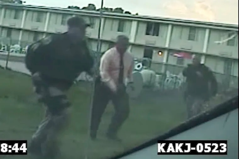 Former Bordentown Township Police Chief Frank Nucera Jr., (pink shirt) is seen on police dashcam responding to a 9-1-1 call at a motel in September 2016. Nucera, who faces a federal hate trial, is accused of assaulting a young black man at the motel during an arrest.