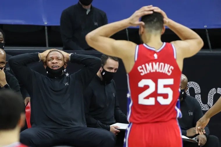 Coach Doc Rivers, left, and Ben Simmons of the SIxers express disbelief in an official's call during their game against the Wizards at the Wells Fargo Center on Wednesday.