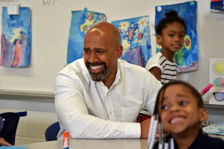 Miles Wilson, the President/CEO of EducationWorks, with kindergarten kids in the after school program at Grover Cleveland Mastery Charter School.