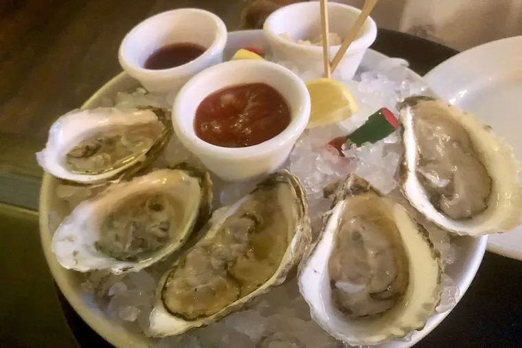 Six oysters for happy hour at P.J. Clarke's.