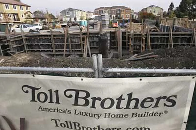 Toll Brothers Inc. said Thursday its fiscal fourth-quarter loss narrowed slightly as it took fewer write-downs on land values, but warned that fiscal 2009 revenue will fall significantly below 2008 levels. (Paul Sakuma/AP Photo)