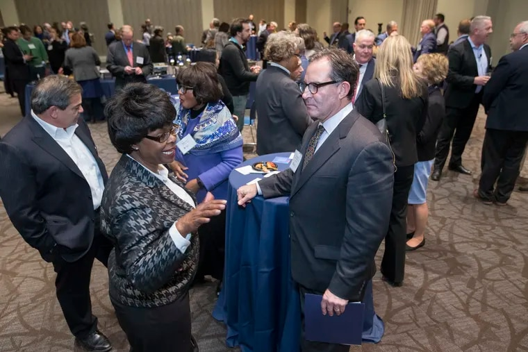 Jeff Hornstein, executive director of the Economy League of Greater Philadelphia, greets a sold-out audience at Wednesday night's launch of Philadelphia Anchors for Growth and Equity, a first-ever citywide effort to get universities and hospitals to buy local.