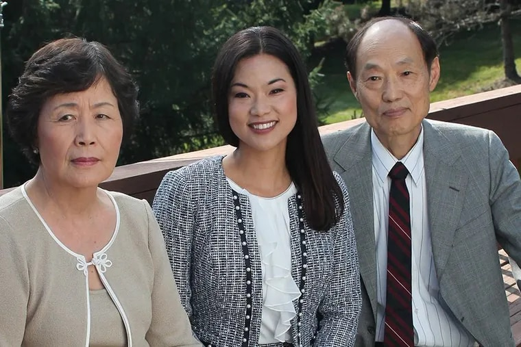 Congressional candidate Pearl Kim is flanked by her mother, Hi Sook Kim, and her father, Kook Kan Kim