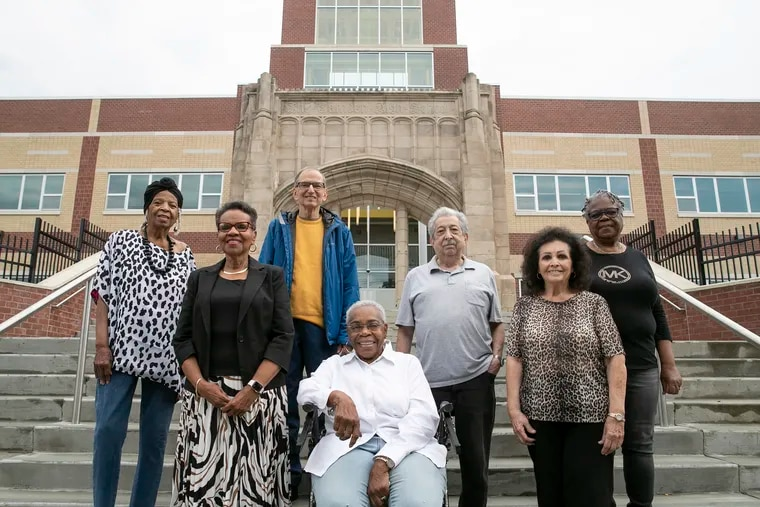 From left, Barbara Fisher Richardson, Delia Ford Brown, Ira Back, A. Dolores Rozier, Ron Venella, Dolores Firth Bailey and Shirley Edwards Tompkins, all of the Camden High School Class of 1960, in front of Camden High School on Tuesday. The class will hold its 60th reunion this weekend, a year late due to the pandemic.