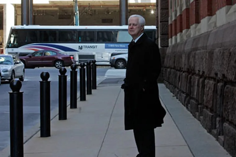 Ted Lewis, president of the Pennsylvania Academy of Fine Arts, stands next to the Academy museum. Behind him is the construction of the Pa. Convention Center. ( Bonnie Weller / Staff Photographer )