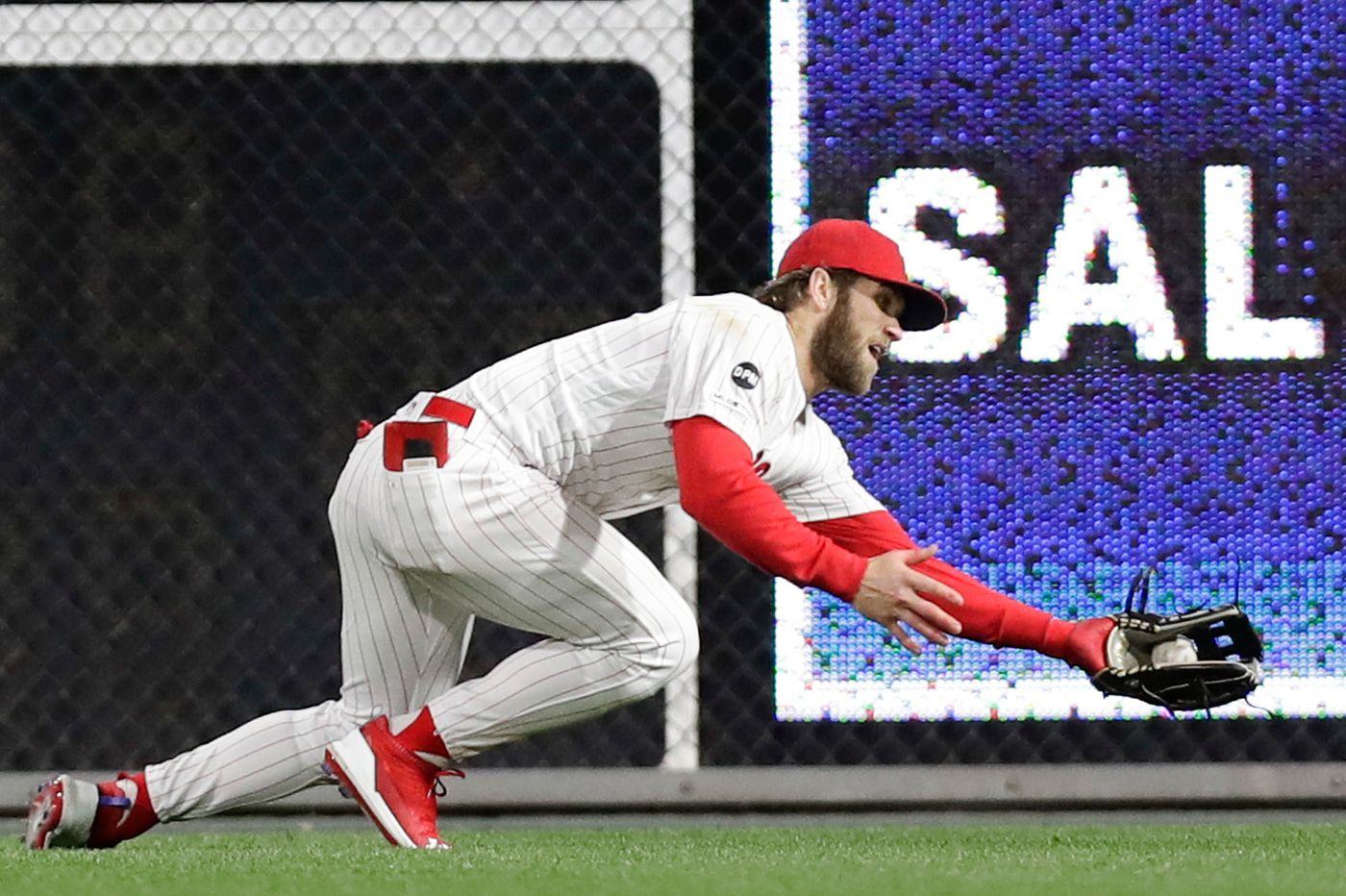 Phillies rally after Bryce Harper's diving catch, beat Brewers, 7-4