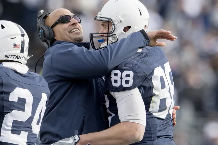 Penn State football coach James Franklin hugs tight end Mike Gesicki after his touchdown in the fourth quarter against Rutgers.  Abby Drey/Centre Daily Times