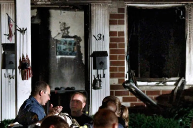 Officials investigating a fire that killed a man just before midnight in an  apartment at Bellmawr Manor Apts, in Bellmawr, N.J.  A woman was also injured.  ( Elizabeth Robertson / Staff Photographer )