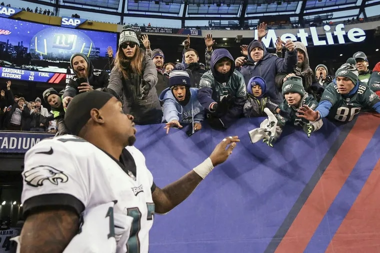 Eagles wide receiver Alshon Jeffery tosses his glove to fans after the Philadelphia Eagles win 34-29 over the New York Giants in East Rutherford, New Jersey on December 17, 2017.