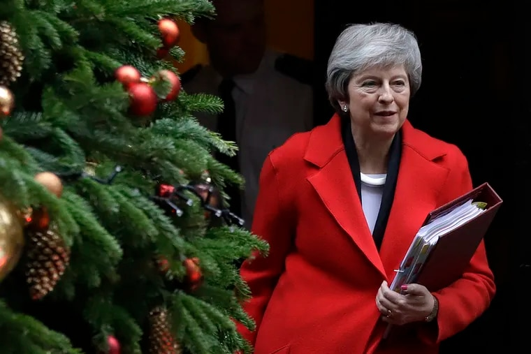 Britain's Prime Minister Theresa May leaves Downing Street in London, Wednesday, Dec. 5, 2018. Britain's Brexit debate has become a bruising battle between lawmakers and Prime Minister Theresa May's government. May is trying to keep her EU divorce deal on track Wednesday after her government was dealt a double blow by Parliament. (AP Photo/Kirsty Wigglesworth)