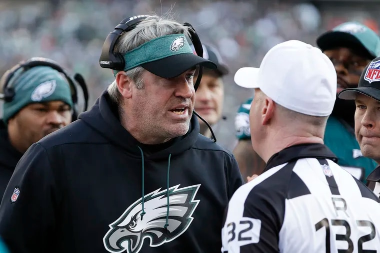 Eagles coach Doug Pederson arguing with referee John Parry during a game against the Houston Texans last season.