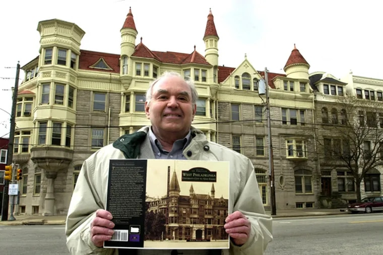 Robert Morris Skaler, an architect who just finished a book about West Philadelphia that he is holding, in front of the Lansdowne Apartments, which are also featured on the book's cover. (APRIL SAUL/Staff)