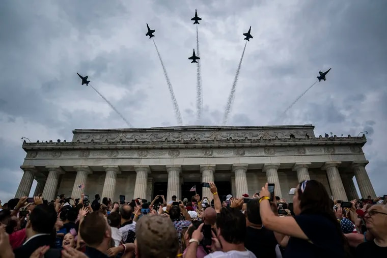 U.S. Navy Blue Angels fly over as President Donald Trump participates in an Independence Day event in front of the Lincoln Memorial on the National Mall on Thursday.