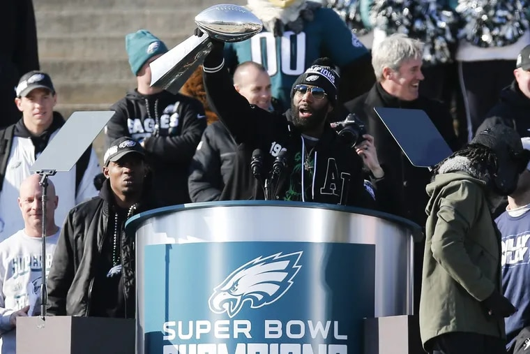 Eagles strong safety Malcolm Jenkins holds the Lombardi Trophy on the steps of the Philadelphia Museum of Art during the Super Bowl LII victory celebration on Thursday, February 8, 2018. YONG KIM / Staff Photographer