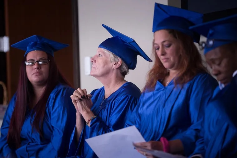 Mary Jill Brown, center, one of the graduates of the Women Working For A Change program, at the program's graduation ceremony at R2L in Center City.