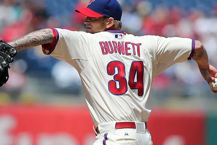 A.J. Burnett throwing against the Braves. (David Maialetti/Staff Photographer)
