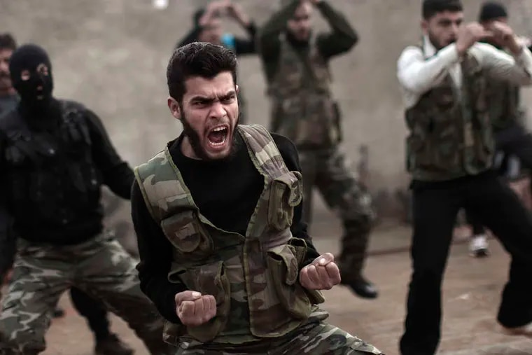 Rebels train in Maaret Ikhwan, Syria. Their instructoris an army defector.