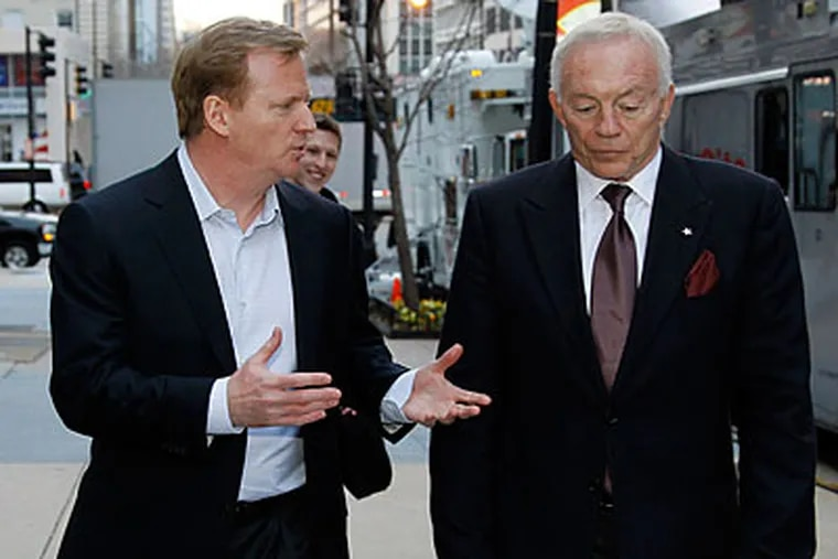 NFL owners such as Jerry Jones (right) don't have to worry about money issues the way fans do every day. (Alex Brandon/AP file photo)