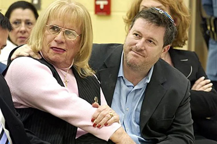 In this Feb. 27, 2006 file photograph, Lily McBeth, left, and Steven Goldstein, of Garden State Equality, listen as opinions are voiced during a school board meeting. (AP Photo/Mary Godleski)